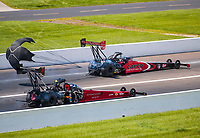 Aug 9, 2020; Clermont, Indiana, USA; NHRA top fuel driver Steve Torrence (far) defeats Leah Pruett during the Indy Nationals at Lucas Oil Raceway. Mandatory Credit: Mark J. Rebilas-USA TODAY Sports