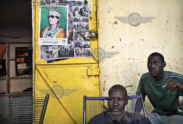 A poster of Muammar Gaddafi stuck to the door of a shop in Segou.
