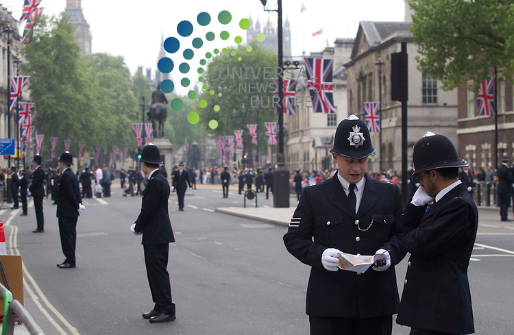 Police stand on the road at Horse Guards  before Kate Middleton and Prince William get married..Picture: Maurice McDonald/Universal News And Sport (Europe).29 April 2011..