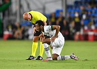 LAKE BUENA VISTA, FL - AUGUST 01: Referee Robert Sibiga checks on the injured Jeremy Ebobisse #17 of the Portland Timbers during a game between Portland Timbers and New York City FC at ESPN Wide World of Sports on August 01, 2020 in Lake Buena Vista, Florida.