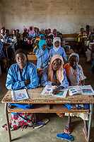 Senegal, Touba.  Students at Al-Azhar Madrasa, a School for Islamic Studies.  The books of the girls in the front row show that they are learning Arabic.