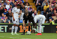 Pictured: Match referee C Pawson (C) marks the spot for a fre kick, Jefferson Montero (L) and Marvin Emnes (R) of Swansea<br />