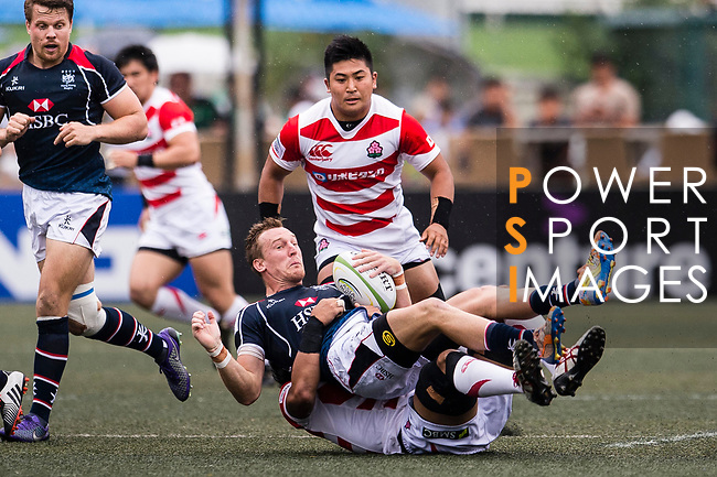 Yoshitaka Tokunaga of Japan (B) puts a tackle on Alex McQueen of Hong Kong (U) during the Asia Rugby Championship 2017 match between Hong Kong and Japan on May 13, 2017 in Hong Kong, China. Photo by Marcio Rodrigo Machado / Power Sport Images