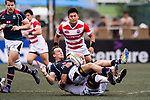 Yoshitaka Tokunaga of Japan (B) puts a tackle on Alex McQueen of Hong Kong (U) during the Asia Rugby Championship 2017 match between Hong Kong and Japan on May 13, 2017 in Hong Kong, China. Photo by Marcio Rodrigo Machado / Power Sport Images