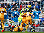 Wes Foderingham gets his paws to Scott McDonald's goal bound effort to steer it clear