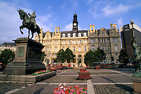 Beautiful flowers in the city square and statue of the Black Prince of Leeds England