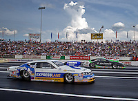 Jun. 2, 2013; Englishtown, NJ, USA: NHRA pro stock driver Allen Johnson (near lane) races alongside Mike Edwards during the Summer Nationals at Raceway Park. Mandatory Credit: Mark J. Rebilas-