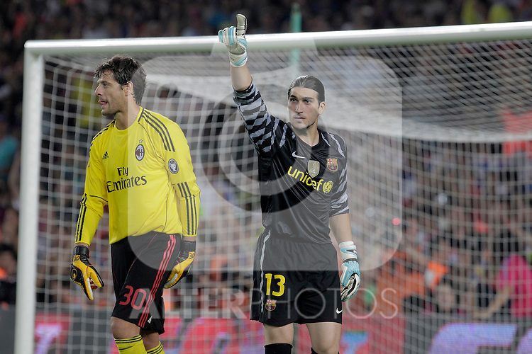 FC Barcelona's Jose Manuel Pinto celebrates the victory in presence of Milan's Amelia during Joan Gamper Trophy. August 25,2010. (ALTERPHOTOS/Acero)