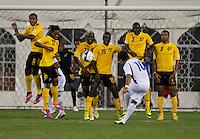 Eliseo Quintinilla (10) of El Salvador takes a shot over the Jamaican wall at RFK Stadium in Washington, DC.  Jamaica defeated El Salvador, 2-0.