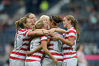 Glasgow, Scotland - Saturday, July 28, 2012: Carli Lloyd of the USA Women's soccer team celebrates with Megan Rapinoe, center, Heather Mitts, Lauren .Cheney and Alex Morgan, after scoring a goal during a 3-0 win over Colombia in the first round of the Olympic football tournament at Hamden Park.