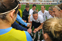 US Women's National Team huddle with Abby Wambach speaking
