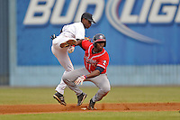 Asheville Tourists second baseman Juan Ciriaco #2 makes the turn on a double play over a hard sliding Felix Marte #28 during game against the Rome Braves  at McCormick Field on June 5, 2013 in Asheville, North Carolina. The Braves won the game 7-4. (Tony Farlow/Four Seam Images)