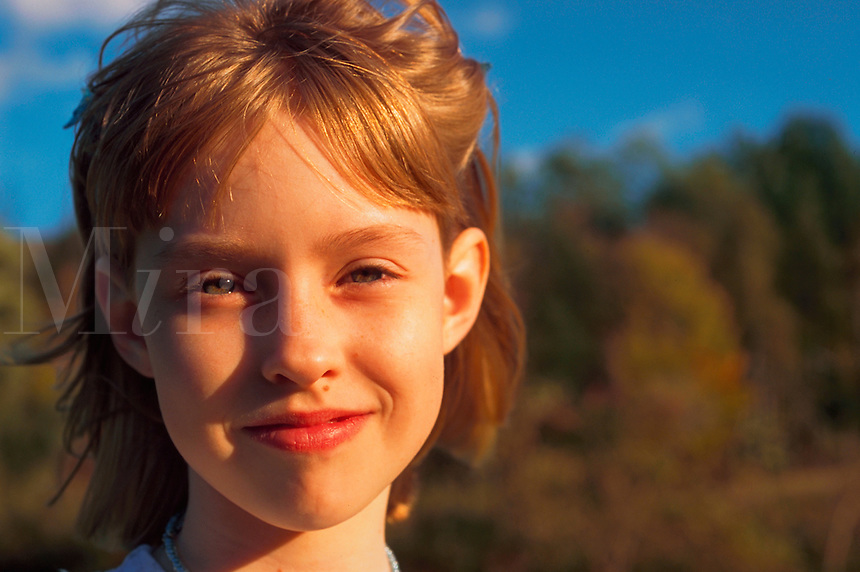 Portrait of a smiling eight year old girl.