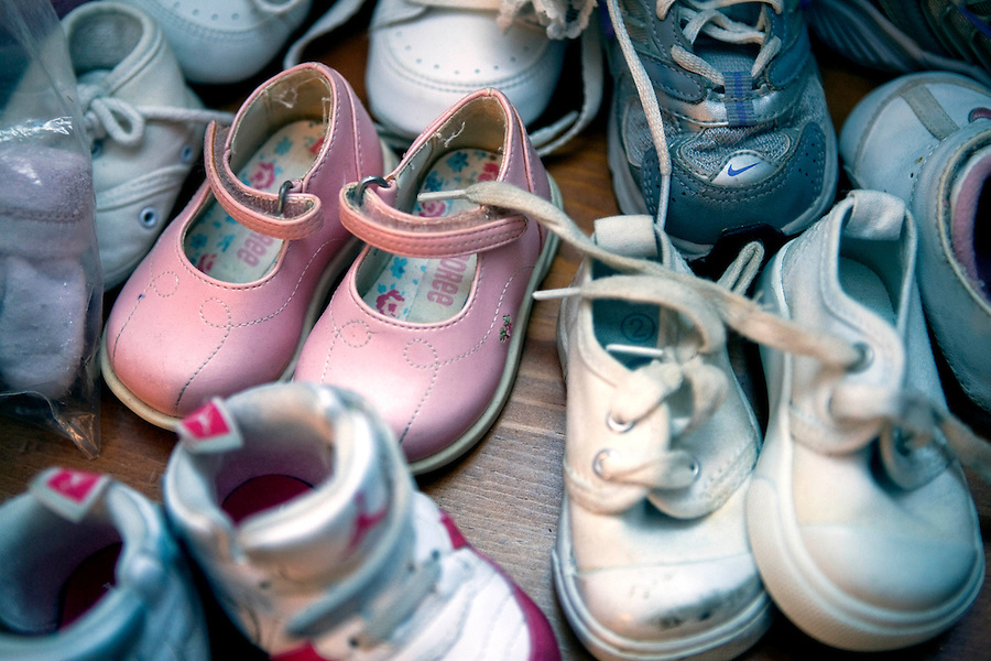 Gently used pink baby shoes and an assortment of sneakers and booties placed together on a child's night stand await the arrival of Brandi's infant daughter, Patience.  She will gain custody upon completion of the longterm residential rehabilitation program at Amos House.  As a client in The Mother-Child Reunification House, Brandi is part of the inaugural class comprised of formerly homeless mothers receiving life skills training, vocational training and therapy in a residential setting.