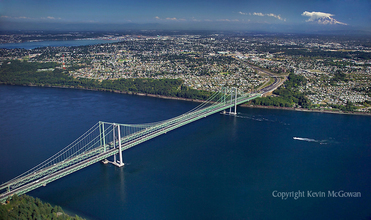 Aerial view of the Tacoma Narrows Bridge and Mt Rainier
