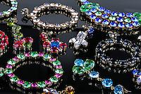 luxury gemstone jewelry on black glossy table