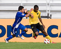 Alvas Powell (5) of Jamaica fights for the ball with Luis Ruiz (3) of Guatemala during the group stage of the CONCACAF Men's Under 17 Championship at Catherine Hall Stadium in Montego Bay, Jamaica. Jamaica defeated Guatemala, 1-0.