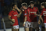 Ronan O'Gara is first to congratulate Casey Lauala after the Munster centre scores a late match winning try..Celtic League.Cardiff Blues v Munster.02.11.12.©Steve Pope