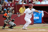 Designated hitter Max Schrock (22) of the South Carolina Gamecocks in an NCAA Division I Baseball Regional Tournament game against the Campbell Camels on Friday, May 30, 2014, at Carolina Stadium in Columbia, South Carolina. The catcher is Campbell's Steven Leonard (6). South Carolina won, 5-2. (Tom Priddy/Four Seam Images)