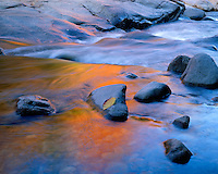 Fall color reflection along the rocky shore of the Swift River; White Mountain National Forest, NH