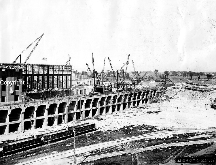 Here is view of power house of the Beauharnois Power Company under construction at Lake St. Louis end of new Beauharnois canal. It is being built to house in 50;000 horsepower units and with its ultimate potential capacity of 2;000;000 horsepower will be largest water power in the world which can be developed with a single power house.<br /> <br /> <br /> <br /> [unknown]<br /> Picture, 1931<br /> <br /> PHOTO : Toronto Star Archives - AQP