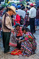 Chichicastenango, Guatemala.  Quiche (Kiche, K'iche') Man and Two Women in Sunday Market.