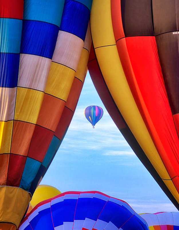 Close up of hot air balloons with one framed. Art and Air Festival. Albany Oregon