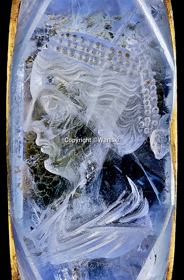 BNPS.co.uk (01202 558833)<br /> Pic: Wartski/BNPS<br /> <br /> Etched portrait of Caesonia, Caligula's last wife - played by Helen Mirren in the controversial 1979 movie.<br /> <br /> Rock of Ages - Emperor Caligula's ring leads stellar exhibition at Royal Jewellers Wartski.<br /> <br /> A precious jewel, created for the most infamous of Rome's Emperor's nearly 2000 years ago, is causing gem collectors from around the world to flock to London as it goes on sale tomorrow.<br /> <br /> The exquisite solid sapphire hololith ring, a former star of the legendary collection of the 4th Duke of Marlborough in the 18th century, is thought to be valued at close to £500,000.<br /> <br /> The sky blue stone is etched with a portrait of his last wife, the notorious Caesonia, said to have been so beautiful that the depraved Emperor paraded her naked in front of his troops. <br /> <br /> She was played by Dame Helen Mirren in the controversial 1979 movie Caligula.<br /> <br /> The ring is the star attraction at a selling exhibition of over 100 engraved gems collected by Royal jewellers Wartski opening on Monday.<br /> <br /> The exhibition has sparked worldwide interest, with collectors from as far afield as Japan queueing outside their premises days before to be first through the door.