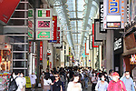 People wearing face masks walk in Osaka, Japan on May 23, 2020, on the first weekend after a coronavirus state of emergency was lifted in Osaka, Hyogo and Kyoto prefectures. (Photo by AFLO)