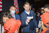 Eric Trump, son of US president Donald Trump, holds a check campaign donation as he greets people and signs MAGA hats and Trump campaign signs after speaking during a Make America Great Again! campaign rally at the DoubleTree by Hilton Manchester Downtown in Manchester, New Hampshire, on Mon., Oct. 19, 2020.