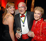 """Megan Reyes and her grandparents Joe Max Taylor and Anita Taylor at the San Luis Salute to """"The Italian Riviera"""" at the Galveston Island Convention Center at the San Luis Friday  Feb. 20, 2009.(Dave Rossman/For the Chronicle)"""