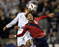 Clint Dempsey(8) of the USA MNT goes for a header with Marcos Antonio Caceres(3) of Paraguay during an international friendly match at LP Field, in Nashville, TN. on March 29, 2011. Paraguay won 1-0.