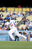 Yasiel Puig #66 of the Los Angeles Dodgers bats against the Atlanta Braves at Dodger Stadium on June 6, 2013 in Los Angeles, California. (Larry Goren/Four Seam Images)