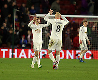 Pictured: Jonjo Shelvey of Swansea celebratingf his team's win with team mate Tom Carroll at the end of the game Sunday 01 February 2015<br />
