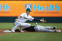 Augusta GreenJackets second baseman Jett Manning (13) reaches for a throw as Ian Dawkins (8) of the Kannapolis Intimidators slides head-first into second base at SRG Park on July 6, 2019 in North Augusta, South Carolina. The Intimidators defeated the GreenJackets 9-5. (Brian Westerholt/Four Seam Images)