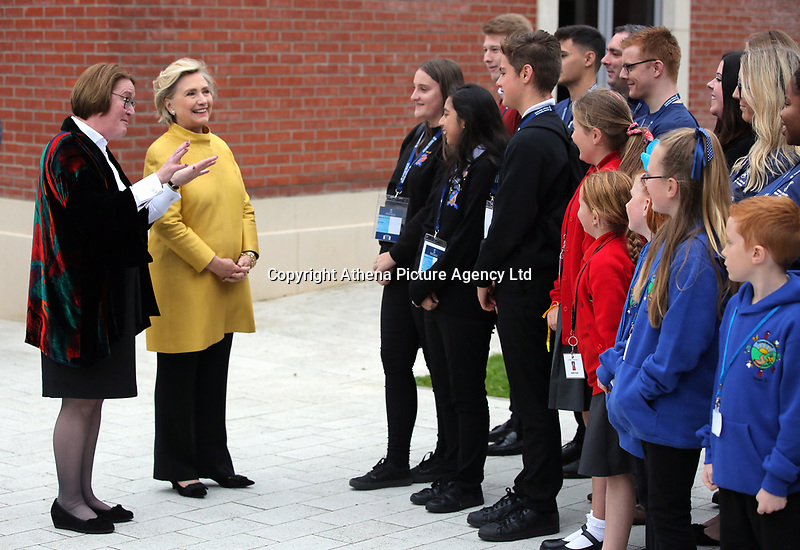 Pictured L-R: Professor Elwen Evans QC and Hillary Clinton and meet young pupils from Narberth, Pentrehafod and Blaen-y-maes Primary Schools, at Swansea University Bay Campus. Saturday 14 October 2017<br />Re: Hillary Clinton, the former US secretary of state and 2016 American presidential candidate will be presented with an honorary doctorate during a ceremony at Swansea University's Bay Campus in Wales, UK, to recognise her commitment to promoting the rights of families and children around the world.<br />Mrs Clinton's great grandparents were from south Wales.