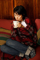 Montreal,  CANADA - Model Released  Illustration Photo - Asian  Girl drinking<br /> <br /> <br /> Photo :  Agence Quebec Presse - Pierre Roussel