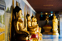 Wat Phra That temple, ancient, beautiful paintings and gold Buddha with blurred Buddha in the background in Doi Suthep near Chiang Mai Thailand