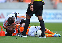 April 28, 2013: Houston Dynamo mid fielder Boniek Garcia #27 is being attended by team doctor during second half of Major League Soccer match in Houston, TX. Houston Dynamo draw 1-1 against Colorado Rapids.