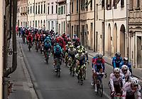 peloton rolling through town<br /> <br /> Stage 2 from Camaiore to Chiusdino (202km)<br /> <br /> 56th Tirreno-Adriatico 2021 (2.UWT) <br /> <br /> ©kramon
