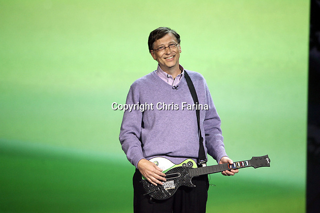 """1/6/08,Las Vegas,Nevada  ---  Chairman for Microsoft Corporation Bill Gates demonstrates """"XBOX 360 Guitar Hero 3"""" during his opening keynote address for the 2008 International Consumer Electronics Show (CES) at the Venetian Resort in Las Vegas. This will be Gates final keynote after twelve years. --- Chris Farina"""