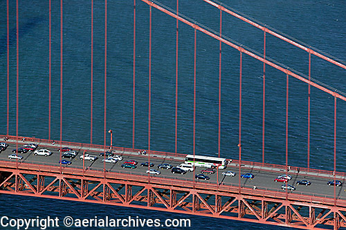 aerial detail view of the suspension cables and traffic at the Golden Gate bridge, San Francisco, California