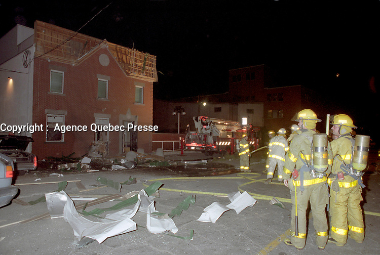 File Photo<br /> <br /> Firemen look at the remain of a bikers bunker on de Bordeaux Street in East End Montreal, CANADA  after a rival gang set up a bomb that destroyed part of the building , October 1st, 1995