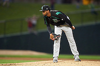 Dayton Dragons relief pitcher Juan Martinez (18) looks in for the sign during a game against the Peoria Chiefs on May 6, 2016 at Dozer Park in Peoria, Illinois.  Peoria defeated Dayton 5-0.  (Mike Janes/Four Seam Images)