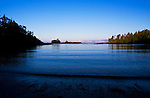 View of the Pacific Ocean seen from Little Beach on the Wild Pacific Trail, Vancouver Island, near the fishing town of Ucluelet, British Columbia and Pacific Rim National Park, Canada at dawn.