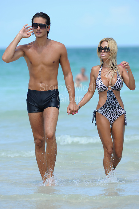 SMG_Shauna Sand_Laurent Homburger_Beach Love_071411_11.JPG<br /> <br /> MIAMI BEACH, FL - JULY 14:  Playmate Shauna Sand, and her husband Laurent Homburger weeks after their domestic violence arrest.  The couple is seen here in Miami looking very much together and in love. The couple kissed, held hands, and looked in the mirror together and played with their hair most of the day; it was like watching two cats groom themselves all day long.   On July 14, 2011 in Miami Beach, Florida,  (Photo By Storms Media Group)<br />  <br /> People:   Shauna Sand_Laurent Homburger<br /> <br /> Must call if interested<br /> Michael Storms<br /> Storms Media Group Inc.<br /> 305-632-3400 - Cell<br /> 305-513-5783 - Fax<br /> MikeStorm@aol.com