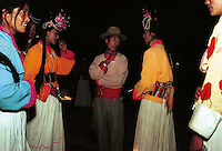 """Mosuo women at a ceremony known as the """"torch shining ceremony"""" that takes place at the end of the fertility festival. During the ceremony women shine torches at potential mates. The Mosuo are one of the world's last matriachal societies. Women from the Mosuo tribe do not marry, take as many lovers as they wish and have no word for """"father"""" or """"husband"""". But the arrival of tourism and the sex industry is changing their culture...PHOTO BY SINOPIX"""