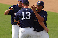 Catcher Erick San Pedro (5), right, of the Potomac Nationals, Class A Carolina League affiliate of the Washington Nationals, greets teammates after the final game of the season on September 5, 2005, at Pfitzner Stadium in Woodbridge, Virginia. (Tom Priddy/Four Seam Images)