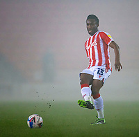 29th December 2020; Bet365 Stadium, Stoke, Staffordshire, England; English Football League Championship Football, Stoke City versus Nottingham Forest; John Obi Mikel of Stoke City crosses the ball in the thick fog