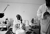 Asmara, Eritrea.November 2002.Birhan Aim Hospital  (Light to the Eye Hospital)..A very happy 63 year old Shiferou from Asmara has her release papers signed as she now sees clearly through both eyes. Dr. Desbele Ghebreghergis claims that in one month her sight will improve.